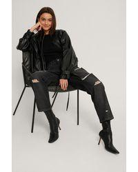 NA-KD Versleten Skinny Jeans Met Hoge Taille - Zwart