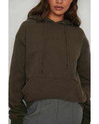 NA-KD Basic Biologique hoodie en peluche surdimensionné - Marron