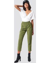 NA-KD - Elastic Waist Seamline Pants Khaki Green - Lyst