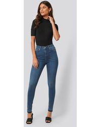 NA-KD Skinny High Waist Open Hem Jeans Tall - Blauw