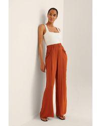 NA-KD Trend Flowy Broek Met Zakdetail - Oranje