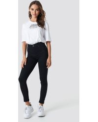 Cheap Monday - High Spray Black Jeans - Lyst