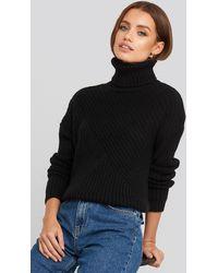 NA-KD Roll Neck Asymmetric Rib Sweater Black