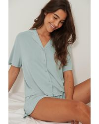 NA-KD Lingerie Modal Shirt Met Korte Mouwen En Losse Pasvorm - Blauw