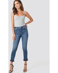 NA-KD - Pom Pom Trim Skinny Jeans - Lyst