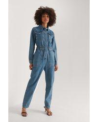 NA-KD Trend Organisch Denim Jumpsuit Met Elastische Taille - Blauw