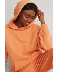 NA-KD Organisch Oversized Hoodie Met Zakken - Oranje
