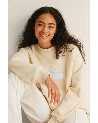 NA-KD Sweatshirt Met Regenboogprint - Naturel