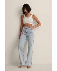 NA-KD Organisch Jeans Met Wijde Pijpen En Asymmetrische Sluiting - Blauw