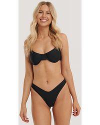 NA-KD Gestructureerd Pop-bikinibroekje Met V-cut - Zwart