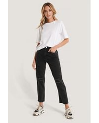 NA-KD Jeans Hohe Taille Used-Look - Schwarz