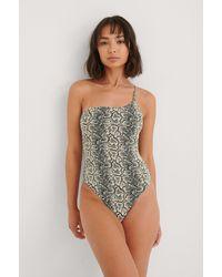 NA-KD - Beige Structured Snake One Shoulder Swimsuit - Lyst