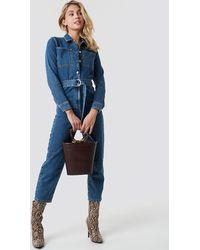 NA-KD Trend Waist Belt Denim Jumpsuit - Blau