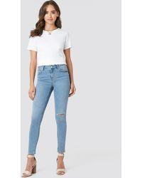 NA-KD Low Rise Distressed Skinny Jeans - Bleu