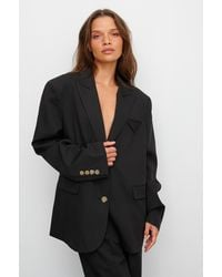 NA-KD Claire Rose X Oversized Blazer Met Zakdetail - Zwart