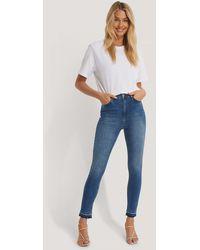 NA-KD - Skinny High Waist Open Hem Jeans - Lyst