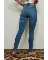 NA-KD Reborn Organisch Skinny Jeans Met Hoge Taille En Ruwe Zoom - Blauw