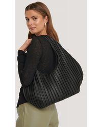 NA-KD Black Striped Embossed Hobo Bag