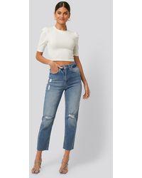NA-KD Versleten Jeans Met Hoge Taille - Blauw
