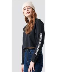 Calvin Klein - Sleeve Institutional Cropped Tee Ck Black - Lyst