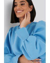 NA-KD Puff Sleeve Split Cuff Sweatshirt Blue