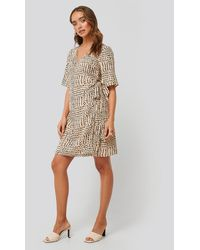 NA-KD - Beige Printed Overlap Dress - Lyst