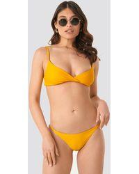 NA-KD Swimwear Bikinibroekje Met Dunne Bandjes - Geel