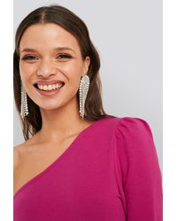 NA-KD Extreme Dropping Strass Earrings - Metallic