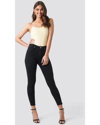 NA-KD Skinny High Waist Raw Hem Jeans - Zwart