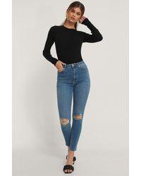 NA-KD Reborn Organisch Versleten Skinny Jeans Met Hoge Taille - Blauw