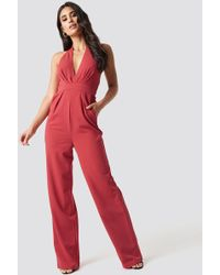 6b81e8eb888a NA-KD - Halterneck Wrap Front Jumpsuit Poppy Red - Lyst