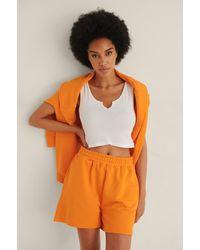NA-KD Trend Short Met Elastische Taille Van Biologisch Katoen - Oranje