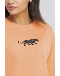 NA-KD Panther Sweatshirt - Oranje