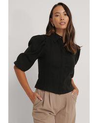 NA-KD Blouse Met Pofmouwen En Shirtdetail - Zwart