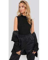 NA-KD - Turtle Neck Sleeveless Ribbed Jersey Top - Lyst