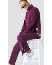 NA-KD - Slit Embroidery Sweatpants Bordeaux - Lyst