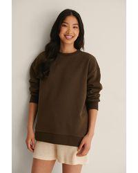 NA-KD Organisch Oversized Sweater - Bruin