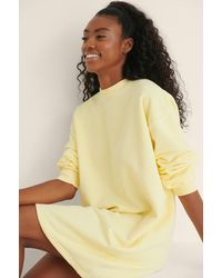 NA-KD Basic Organische Oversized Sweatshirtjurk - Geel