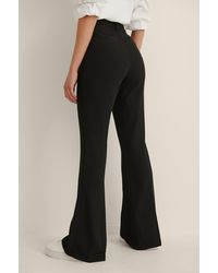 NA-KD Uitlopende Pantalon Met Geplooide Voorkant - Zwart