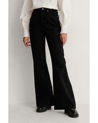 NA-KD Organisch Bootcut Jeans - Zwart