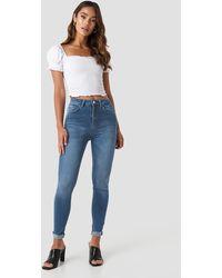 NA-KD Skinny Raw Hem Jeans - Blauw