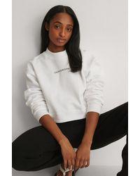 Calvin Klein Kurzer Pullover - Weiß