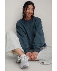 NA-KD Organisch Oversized Geborsteld Sweatshirt - Blauw
