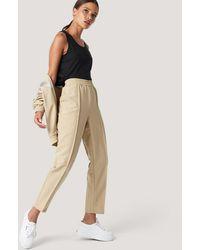 NA-KD Beige Elastic Waist Seamline Pants - Natural