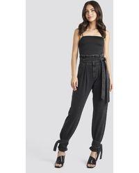 NA-KD - Tie Hem Paperbag Waist Jeans - Lyst