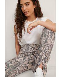 NA-KD - Beige Faux Snake Skin Pants - Lyst