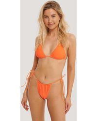 NA-KD Swimwear Bikinibroekje Met Dunne Bandjes - Oranje