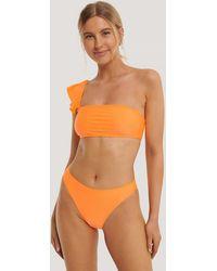 NA-KD Swimwear Hochgeschnittenes Bikinihöschen - Orange
