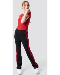 Calvin Klein - Hr Side Stripe Track Pant Ck Black/racing Red - Lyst