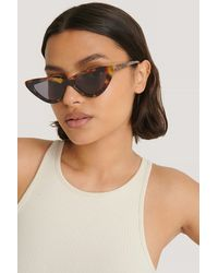 NA-KD Long Edge Cateye Sunglasses - Bruin